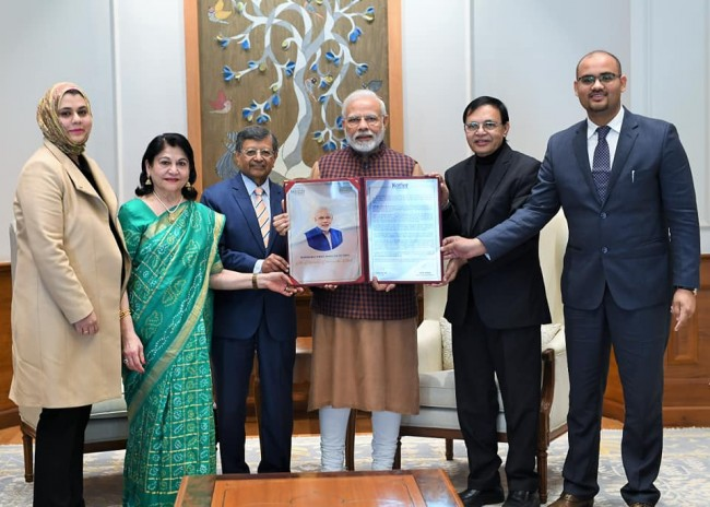 Dr Jag Sheth presents PM Modi with Philip Kotler Presidential Award